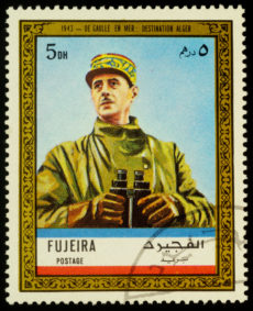 "A stamp printed in Fujeira shows General de Gaulle in uniform with binoculars at sea in 1943: destination Algiers, series ""Charles de Gaulle"", circa 1972"